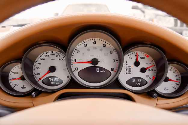 white motorcycle cluster gauge
